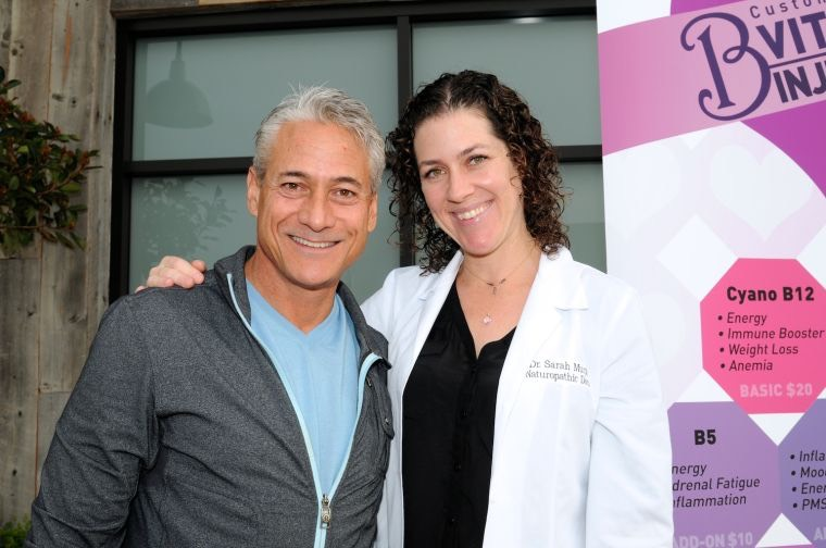 Malibu resident and Olympian Greg Louganis visits with Malibu Healing Center's Dr. Sarah Murphy, as she administrates Vitamin